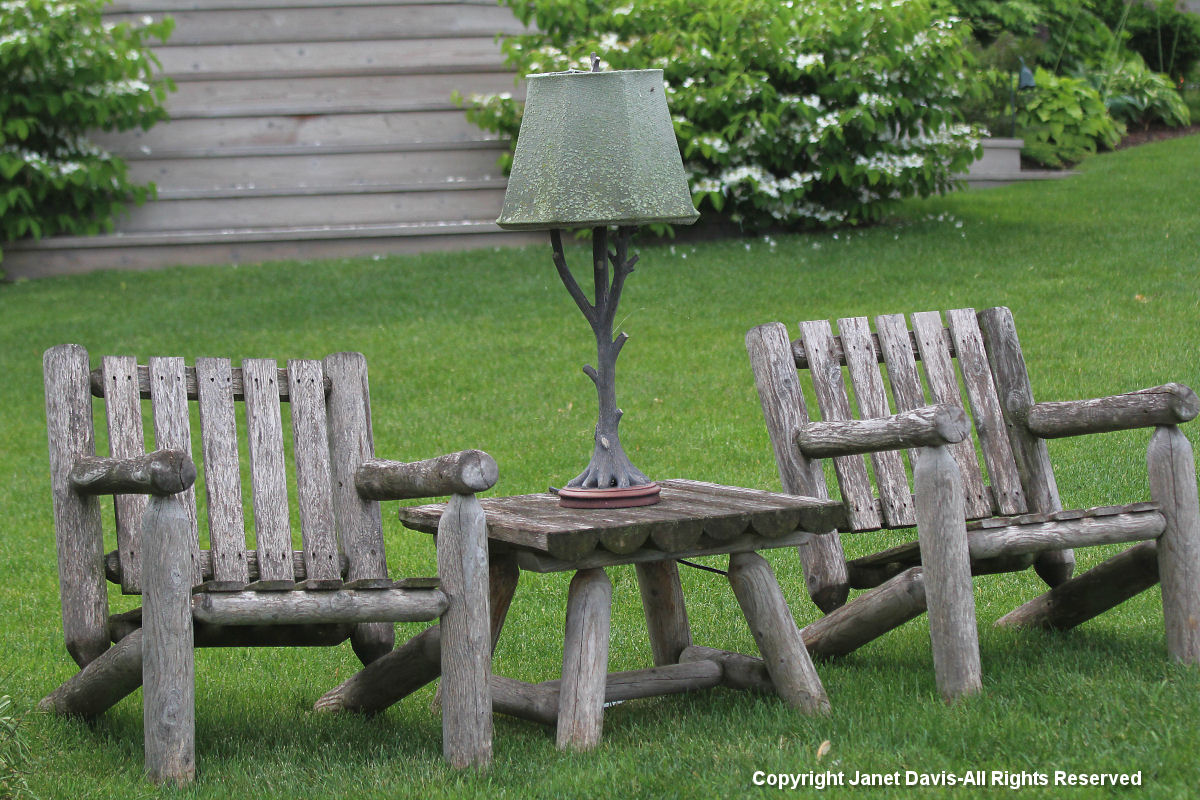 Garden chairs and rustic lamp